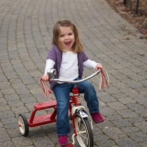 Molly loves riding her new tricycle